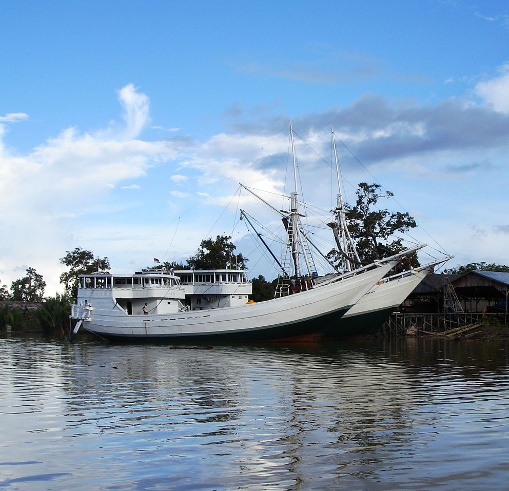 Two Cargo Phinisi on the Sangkulirang River, Borneo - Photo Copyright 2006 Michael Kasten